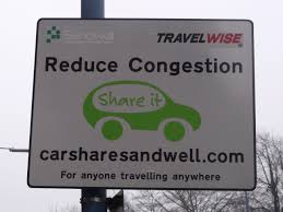sharing car congestion reduction sign
